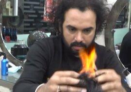 Kunden stehen Schlangen: der Friseur schneidet Haare mit Hammer und Feuer