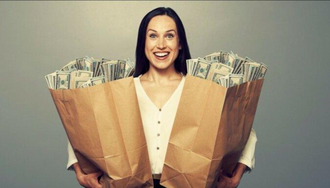 Eine Frau mit dem Geld. Quelle: podarokgid