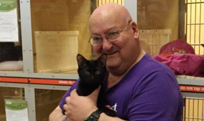 Der Mann und seine Katze. Quelle: murcat